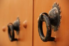 Door Handles. Two iron Door Handles on a wooden door in Meknes, Morocco Stock Photos