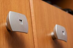 Door handles on a wooden locker close up. Copy space royalty free stock image