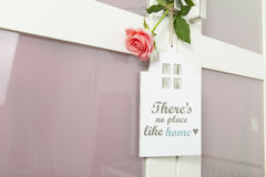 Door hanger. With no place like home with rose stock photography