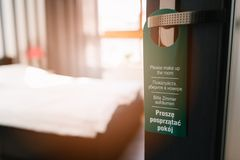 Door hanger please make up my room in 4 languages Royalty Free Stock Photos