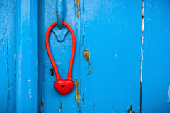 Door with heart shape padlock hanging on handle. Royalty Free Stock Photography