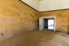 Door held open by sand. Kolmanskop, Namibia royalty free stock images
