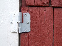 Door hinge. Close-up of a wooden door with an aluminium hinge Royalty Free Stock Photo