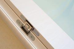 Door hinge. A modern door hinge, a closeup shot stock images