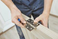 Door hinge installation Stock Photo