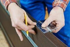 Door hinge installation. Close-up carpenter process of wood door hinge installation royalty free stock images