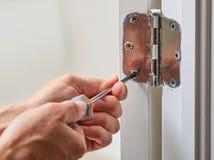 Door hinge installation. Stock Photos