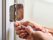 Door hinge installation. Stock Image