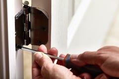 Door hinge installation. Royalty Free Stock Photography