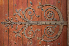 Door hinge. Ornamented door hinge in arles, france stock photos