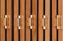 Door hinges. Hinges on folding doors in vintage style house Royalty Free Stock Photos