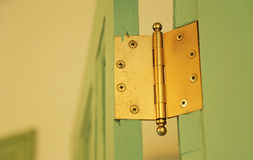 Door hinges. Landscape of green door and golden hinged room Royalty Free Stock Images