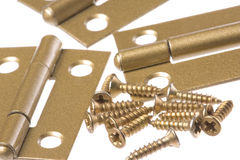 Door Hinges and Screws Macro Isolated. Isolated macro image of door hinges and screws Royalty Free Stock Images