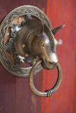 Door holding and knocker. Old style door holding and knocker Royalty Free Stock Images