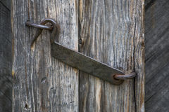 The door hook closes an old wooden door Royalty Free Stock Photo