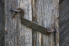 The door hook closes an old wooden door Royalty Free Stock Photo