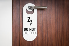 Door of hotel room with sign do not disturb royalty free stock photography