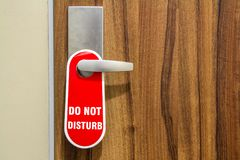 Door of hotel room with sign please do not disturb. Royalty Free Stock Image