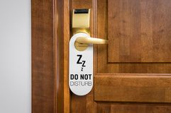 Door of hotel room with sign please do not disturb Stock Image