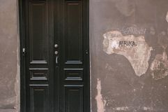 Closed door with symbolic chipping Royalty Free Stock Images