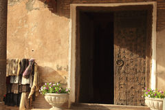 The door in Ichan Kala in Khiva city, Uzbekistan. Ichan Kala is the walled inner town of the city of Khiva, Uzbekistan. The old town retains more than 50 stock photo