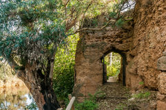 Door inside the rampart of medieval stone that surrounds village of Niebla, Huelva, Spain stock images