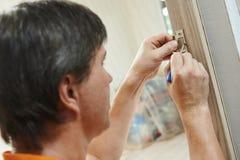 Door installation work Stock Photos