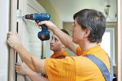 Door installation workers Stock Photo