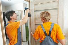 Door installation workers stock images