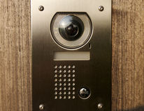 Door intercom on wood royalty free stock photo