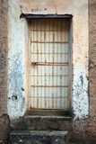 Door with iron bars Royalty Free Stock Photography