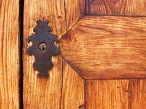 Door iron locker. Wooden gate doors with ancient iron locker Royalty Free Stock Photos