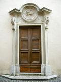 Door in Italy. A beautiful brown wooden door of an ancient house in Italy outdoors Royalty Free Stock Photos