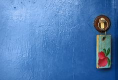 Door  and key. Light blue  door  and key Stock Photography