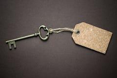 Door key and blank label Stock Photo