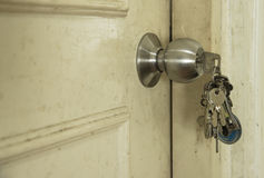 The door. The key on the dirty door Royalty Free Stock Photo