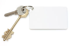 Door key with a pure card for the text. Door key with a pure card Royalty Free Stock Photos