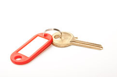 Door key and tag. Door key with tag for label isolated on white background Stock Images