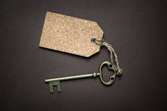 Door key and blank label Royalty Free Stock Photos