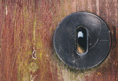 Door keyhole closeup copyspace. Old vintage scrached door with keyhole Royalty Free Stock Image