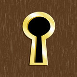 Door keyhole of golden metal Stock Photo