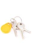 Door keys and circle yellow key card Royalty Free Stock Image