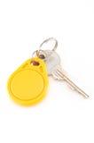 Door keys and circle yellow key card Stock Image