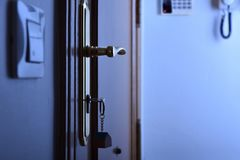 Door with keys in the lock security night concept Royalty Free Stock Image