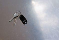 Door keys on metal table Royalty Free Stock Photography