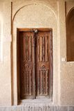 Door. At the Khan-e Lary house courtyard at Yazd, Iran. The Khan-e Lary House is the mansion of a welthy merchant family. Built in 1860 it is a fine example of Royalty Free Stock Photos