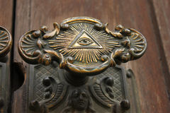 Door knob with the all seeing eye on. The Door knob to Storkyrkan in Stockholm with the all seeing eye on it royalty free stock images