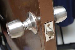 Door knob assembly on a wooden door. Stock Photo