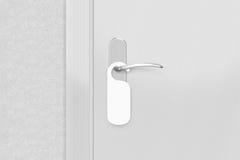 Door knob with blank doorhanger mock up. Empty white flyer mocku Royalty Free Stock Photography