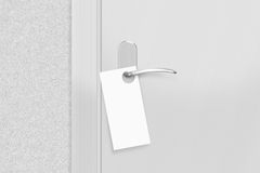 Door knob with blank flyer mock up. Empty white flier mockup. Hang on door handle. Leaflet design on entrance doorknob.rr Stock Photography